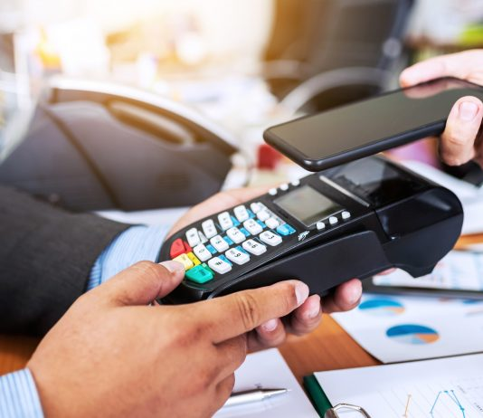 Business man payment by NFC technology with credit card reader m
